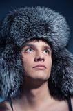 Man wearing fluffy hat Royalty Free Stock Photos