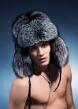 Man wearing fluffy hat Royalty Free Stock Images