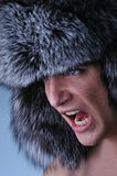 Man wearing fluffy hat Stock Photo