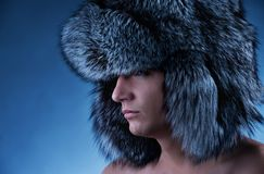 Man wearing fluffy hat Stock Image