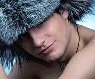 Man wearing fluffy hat Stock Photography