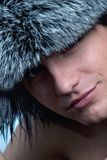 Man wearing fluffy hat Royalty Free Stock Image