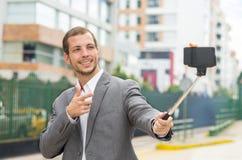 Man wearing formal clothing posing with selfie Stock Photo