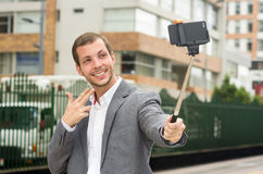 Man wearing formal clothing posing with selfie Stock Photography