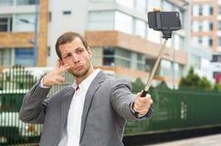 Man wearing formal clothing posing with selfie Stock Photos