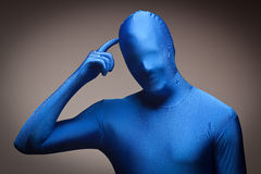 Man Wearing Full Blue Nylon Bodysuite Scratching H Royalty Free Stock Photo