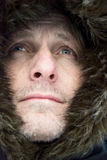 Man wearing furry hat Stock Photography