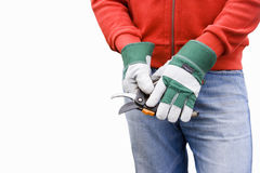 Man wearing gardening gloves, using secateurs, mid-section, cut out Stock Photo