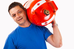 A man wearing a gas cylinder on his shoulder Stock Images