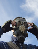 Man wearing gas-mask Stock Images