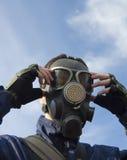 Man wearing gas-mask Stock Images
