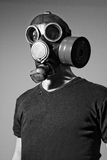Man wearing gas mask. Black&Wite, standing on gray background stock photography