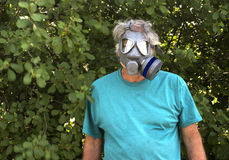 Man wearing a gas mask Stock Images