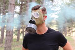 Man wearing gas mask and experimenting panic stock photography