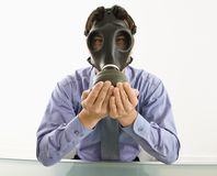 Man wearing gas mask with hands over mouth. Royalty Free Stock Photos