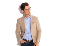 Man wearing glasses while posing with hand in pocket. Portrait of handsome man wearing glasses while posing with hand in pocket, looking away from the camera in Stock Photography