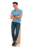 Man wearing glasses posing leaning on wooden box Stock Image
