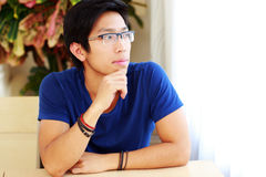 Man wearing glasses sitting at the table Royalty Free Stock Photography