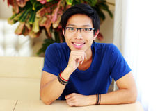 Man wearing glasses sitting at the table Royalty Free Stock Images