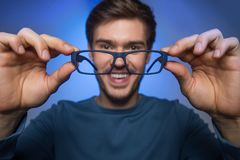 Man wearing glasses to improve vision. Royalty Free Stock Image