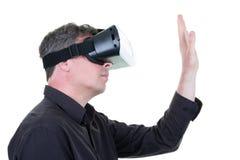 Man wearing goggle headset virtual reality world VR concept tech. A Man wearing goggle headset virtual reality world VR concept tech royalty free stock photography