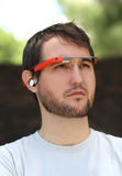 Man Wearing Google Glass. Es with ear piece Royalty Free Stock Images