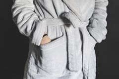 Man wearing gray bathrobe