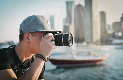 Man Wearing Gray Cap Taking Photograph Using Camera Royalty Free Stock Image