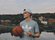 Man Wearing Gray Crew Neck Shirt Holding Basketball Stock Photography