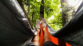 Man Wearing Gray Shoes Lying on Hammock Stock Photos