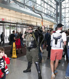 Man wearing Green Arrow costume at NY Comic Con Stock Image