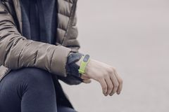 Man wearing green electronic watch