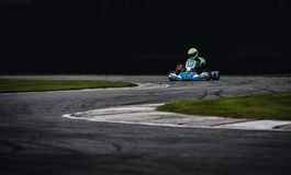 Man Wearing Green Helmet Riding Go Kart stock photo