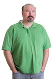 Man Wearing Green Shirt with Hands in Pockets Royalty Free Stock Photography