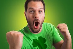 Man wearing green t- shirt with shamrock printed on it celebrating St. Patrick's day royalty free stock photography