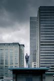 Man Wearing Grey Levitating on Top Shed Under Grey Skies Royalty Free Stock Photography