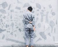 Man Wearing Grey Long Sleeve T Shirt Beside Wall Royalty Free Stock Photo