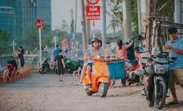 Man Wearing Grey Shirt Riding on Orange Motor Scooter at Daytime Stock Photo