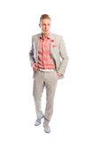 Man wearing grey suit, holding hand in the pants pocket Stock Photography
