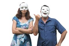 Man wearing a happy face mask laughing at a woman who wearing a royalty free stock photo
