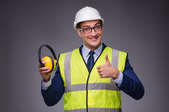 The man wearing hard hat and construction vest. Man wearing hard hat and construction vest Royalty Free Stock Image