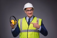 The man wearing hard hat and construction vest. Man wearing hard hat and construction vest Royalty Free Stock Photo