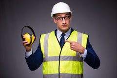 The man wearing hard hat and construction vest. Man wearing hard hat and construction vest Stock Photography