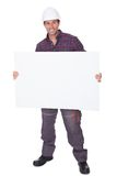 Man Wearing Hard Hat Holding Placard Stock Images
