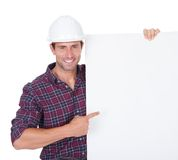 Man Wearing Hard Hat Holding Placard Stock Image