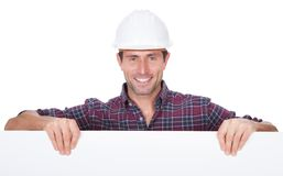 Man Wearing Hard Hat Holding Placard. On White Background Royalty Free Stock Photo