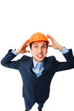 Man wearing hardhat. Young man wearing hardhat isolated on white stock photography