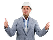 Man wearing a hardhat cheering in jubilation. And punching the air with his fist as he celebrates a success, conceptual of a builder, architect or engineer royalty free stock images