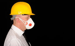Man wearing hardhat and mask Stock Images