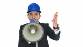 Man wearing a hardhat speaking into a megaphone Royalty Free Stock Images